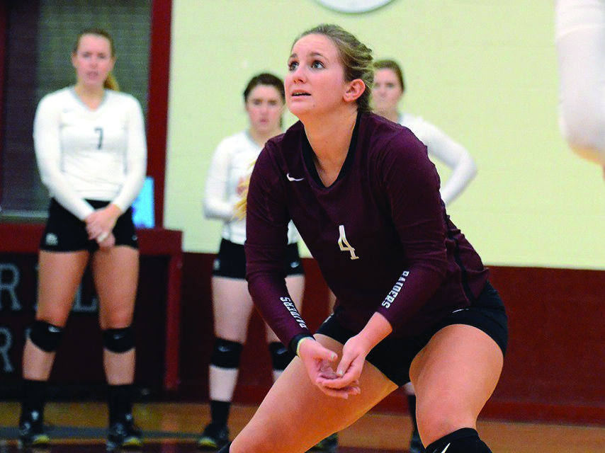 Junior Madison McAndrews comes in strong for the Raiders with a personal best of 34 digs, keeping the ball in play.