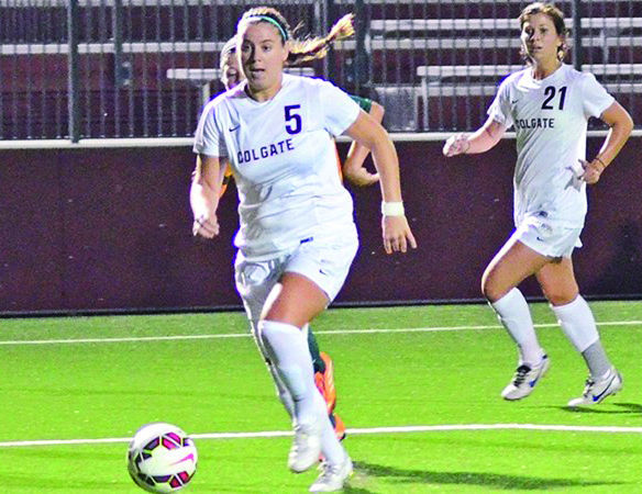Senior forward Jenna Raepple leads the offense down the field in a tournament at Syracuse University last weekend.