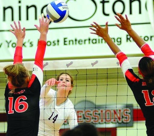 Junior right-side and outside hitter Katie Stebbins spikes the ball in a victorious effort at home.
