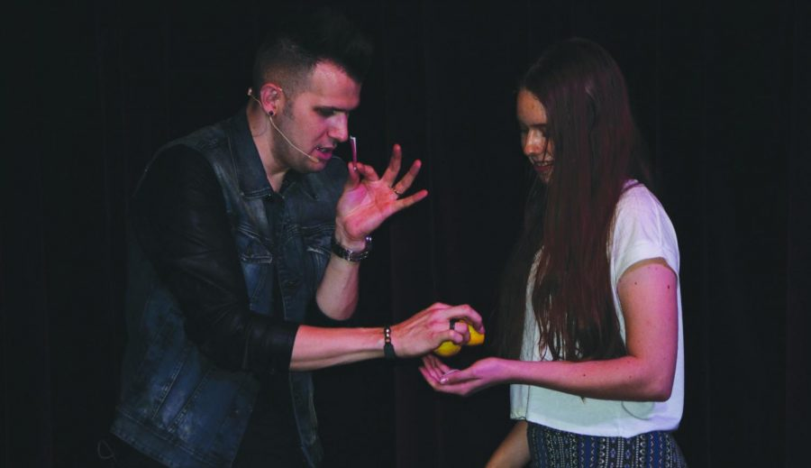 Illusionist Joel Meyer used audience participation to immerse students in his magical performance.