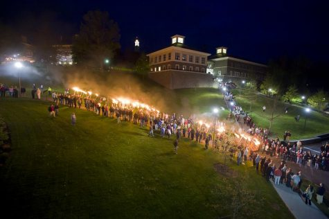 The senior graduating class of 2010 walks down the hill carrying torches in the traditional Torchlight Ceremony the night before Commencement. The seniors walk down the hill and circle Taylor Lake, whereupon they sing the Alma Mater. The ceremony began in 1930 by Frank M. Williams, class of 1895 and president of the Alumni Corporation, and Bernard P. Taylor, class of 1924 and secretary of the college.