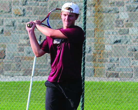 Junior Win Reynolds wins singles match against Roberts Wesleyan; featured in this match was Reynolds' signature hammer stroke.