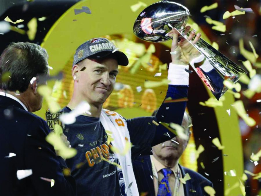 """The Sheriff"" Peyton Manning poses with the Lombardi Trophy following the Broncos' Super Bowl 50 victory. Manning has yet to announce a decision regarding his retirement."