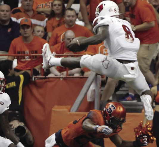 Lamar Jackson hurdles a Syracuse defender en route to a 62-28 win.