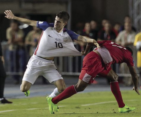 Young and rising American star Christian Pulisic fights off a Panamanian defender for a 50-50 ball. The United States needs to be more aggressive in order to produce on offense or else they could miss out on qualifying.