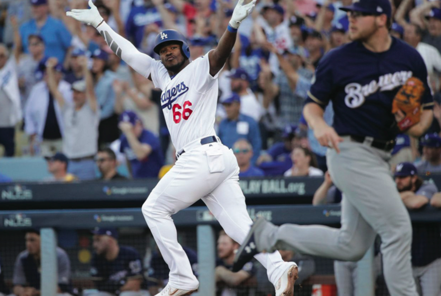 Los+Angeles+Dodgers+outfielder+Yasiel+Puig+celebrates+a+home+run+against+the+Milwaukee+Brewers+in+Game+5+of+the+NLCS.+Puig+brings+electric+energy+to+the+Dodgers%2C+but+the+Boston+Red+Sox+will+hope+to+stymie+his+celebration+in+the+Fall+Classic.
