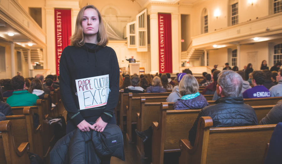 Protestors stand in the Colgate Memorial Chapel's aisles with their backs to lecturer Alan Dershowitz as he takes the stage and begins his lecture.