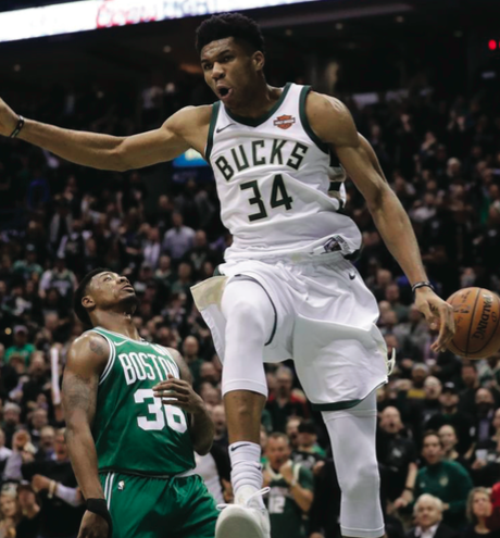 Milwaukee Bucks guard Giannis Antetokounmpo is top five in points (27.6) and rebounds (13.2) per game. He is earning a place in the MVP conversation.