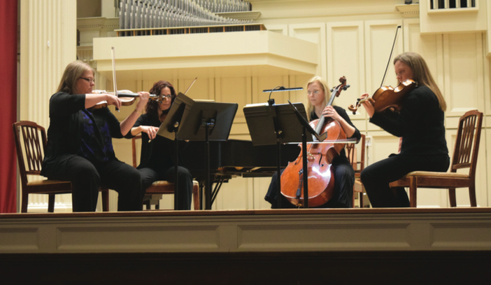 Assistant Professor of Music and Composer Ryan Chase playedsome of his music with members of the Society for New Music.