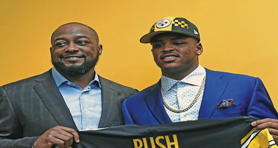 Tenth overall pick Devin Bush (right) and Pittsburgh Steelers head coach Mike Tomlin (left) pose for a photo following Bush's selection by the Steelers via a draft night trade agreement with the Denver Broncos.