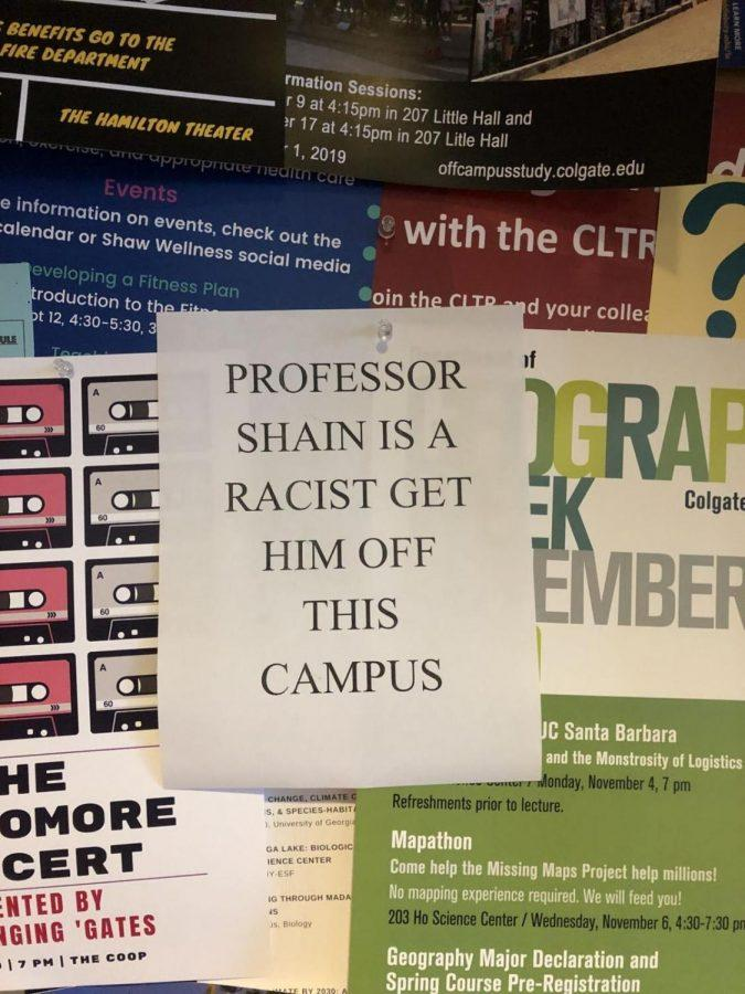A+flyer+put+up+in+the+COOP+that+reads%2C+%22PROFESSOR+SHAIN+IS+A+RACIST+GET+HIM+OFF+THIS+CAMPUS.%22+These+posters+were+also+found+in+McGregory+Hall+and+Alumni+Hall.