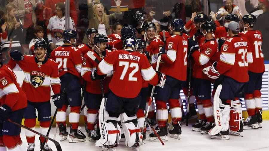 The Florida Panthers celebrate after scoring in overtime during an NHL hockey game against the Anaheim Ducks, Thursday, Nov. 21, 2019, in Sunrise, Fla. Panthers win 5-4. (AP Photo/Brynn Anderson)
