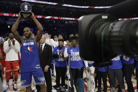 Kawhi Leonard of the Los Angeles Clippers holds up his NBA All-Star Game Kobe Bryant MVP Award after the NBA All-Star basketball game Sunday, Feb. 16, 2020, in Chicago. (AP Photo/Nam Huh)