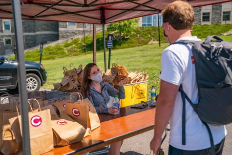 A first-year student checks in after arriving to campus. All students picked up a welcome bag including two Colgate masks, a thermometer and hand sanitizer before beginning the mandatory quarantine until Sept. 8.