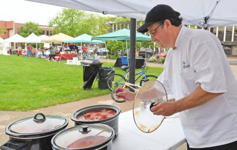 Chef Richard Rossi checks the temperature of his Rossi's Meatballs at his stand at the Rome Farmer's Market. Rossi is frrom Canastota and will be here every week selling his meatballs.