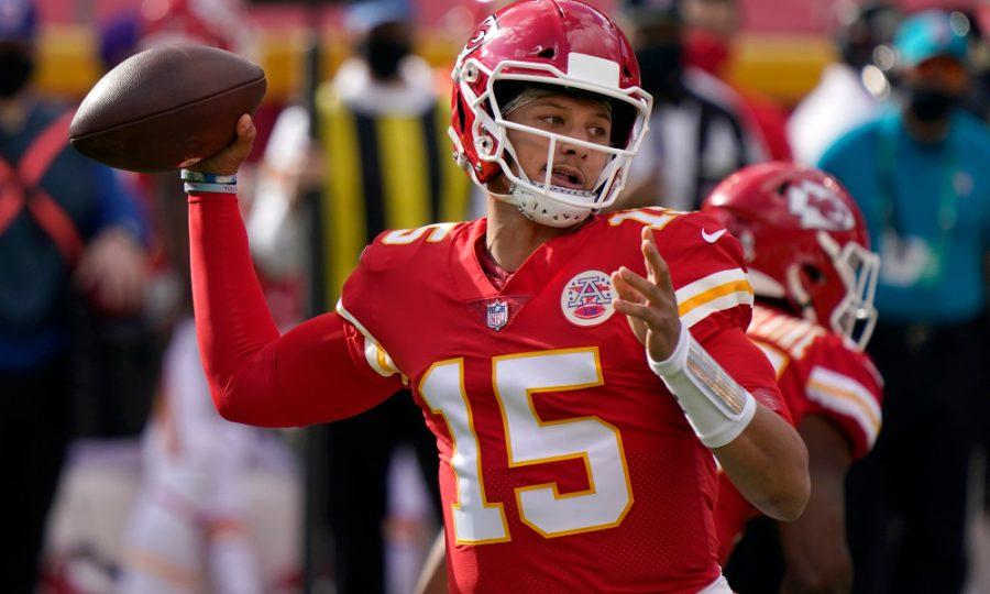 Kansas City Chiefs quarterback Patrick Mahomes (15) passes against the Carolina Panthers during the first half of an NFL football game in Kansas City, Mo., Sunday, Nov. 8, 2020. (AP Photo/Jeff Roberson)