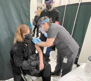 Lori Garris becomes one of the first Madison county residents to be vaccinated, recently receiving the Moderna vaccine.