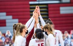 HUDDLING UP: The Colgate Women's Volleyball team comes together amidst a close game to NCAA powerhouse UNLV, a top team in the country.