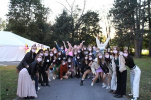 REWORKING RECRUITMENT: Current members of Gamma Phi Beta Sorority gather in masks to welcome potential new members.
